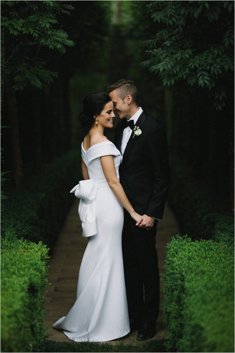 A newly married couple pose at their southern highlands marquee wedding