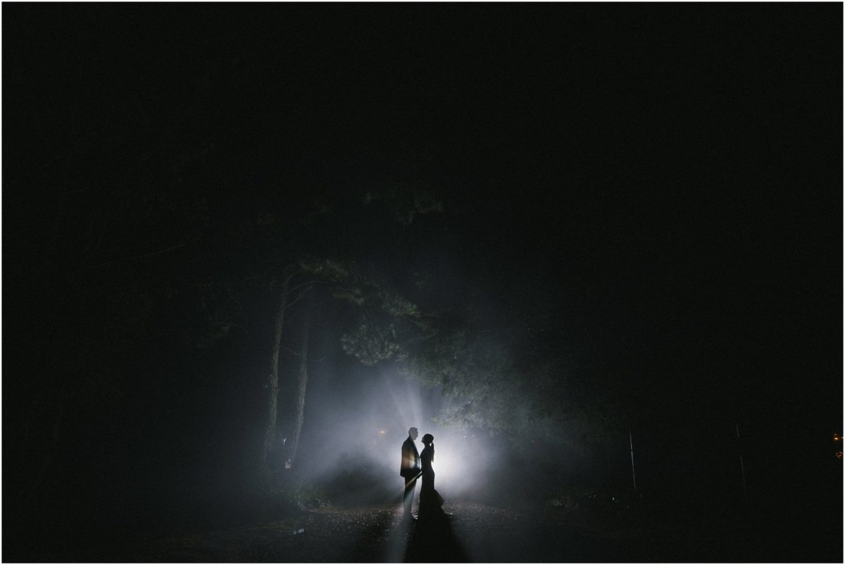A newly married couple pose for a photo in the late night fog after their Allview Escape Blue Mountains Wedding