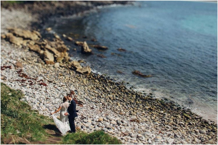 A newly married couple on the beach after their Bannisters Mollymook wedding