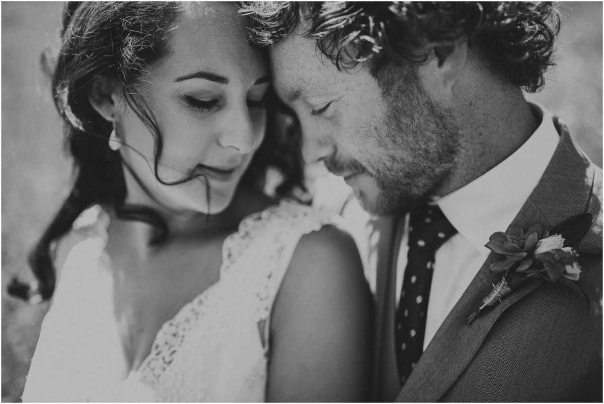 A couple snuggle close on their New Zealand wedding day