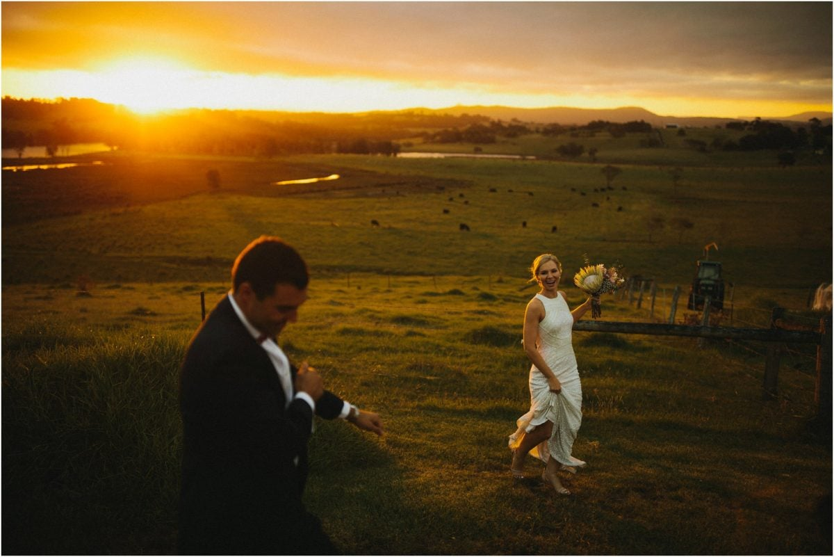 A newly married couple dance in a field at sunset during their Cupitts Winery wedding