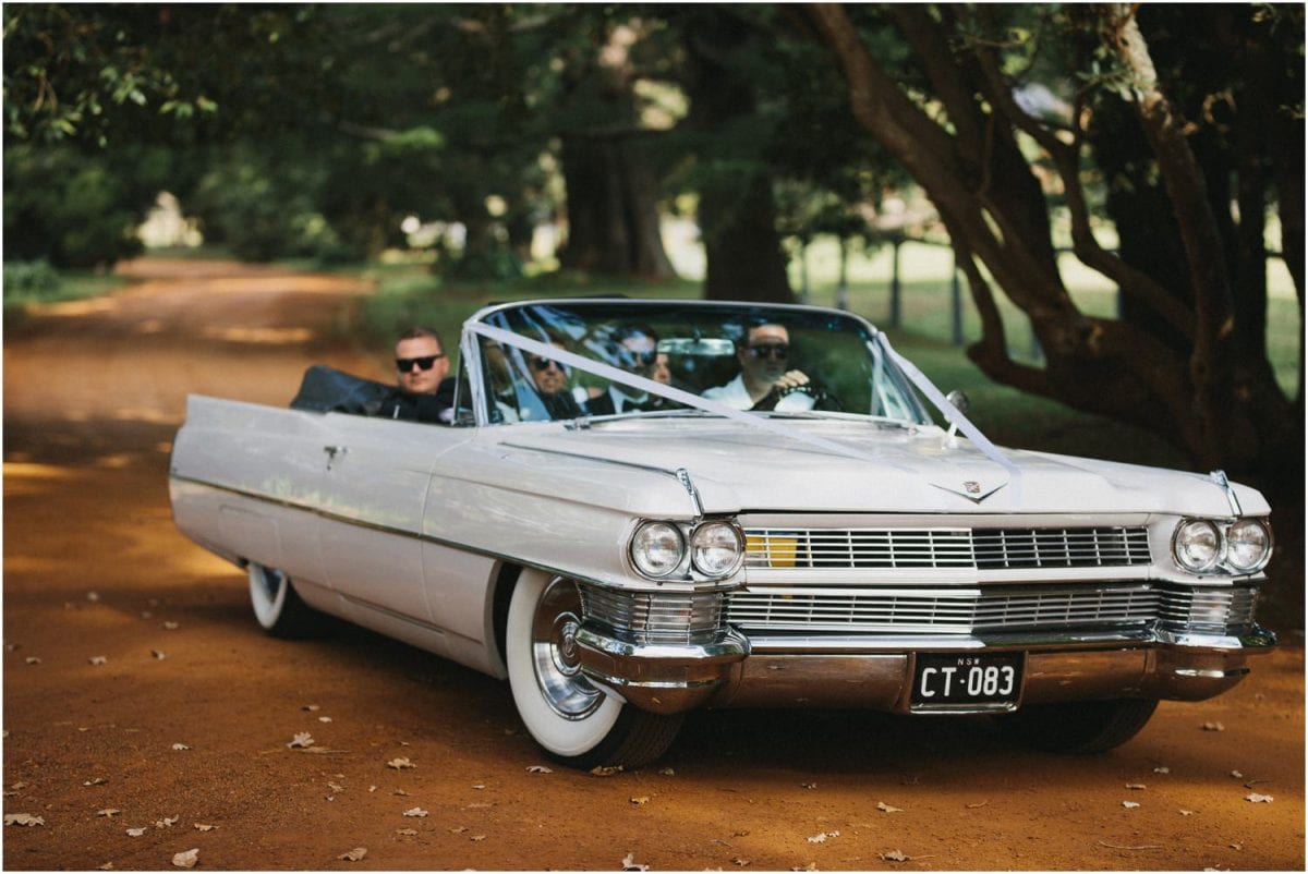 Old Cadillac wedding car at a Bendooley Berrima wedding