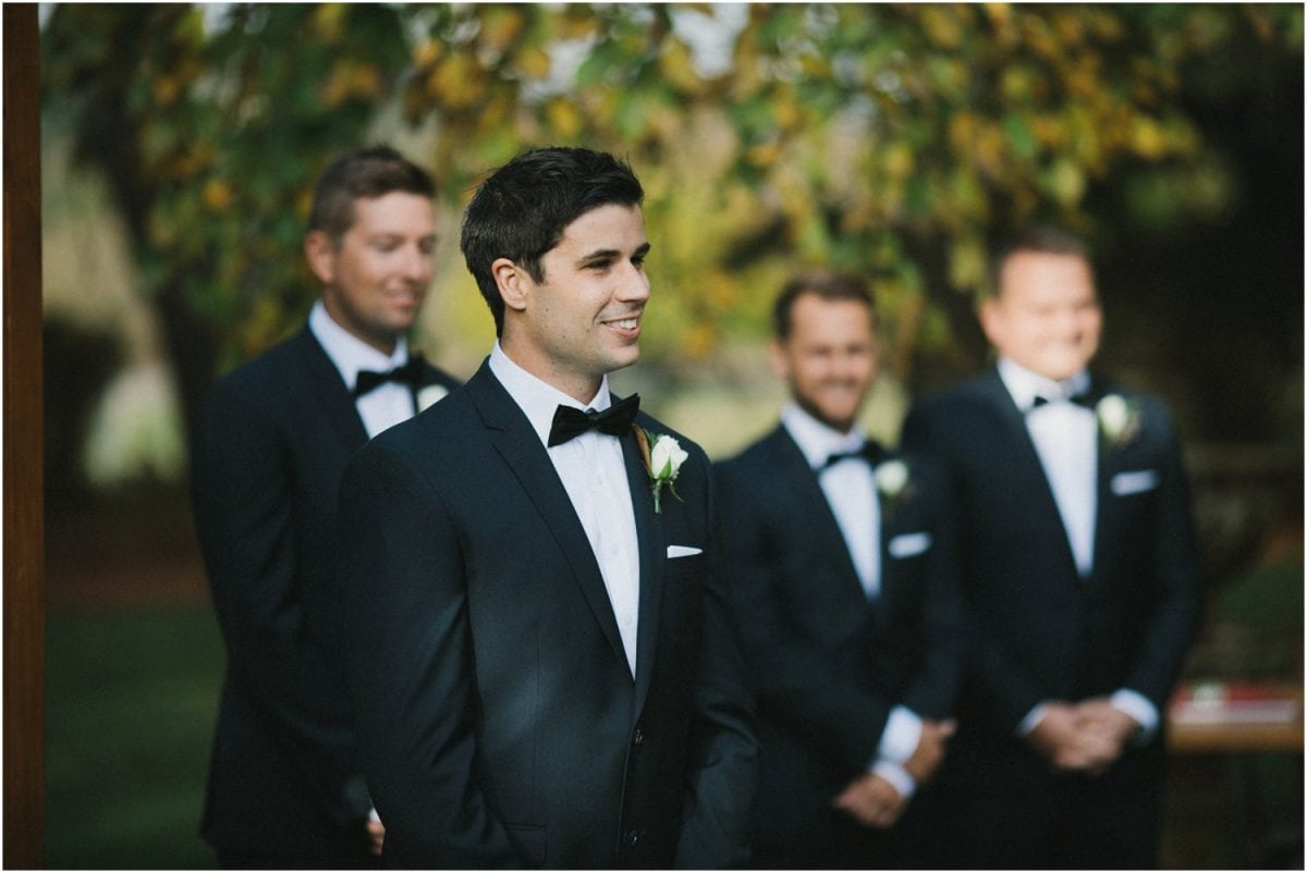 Groom watches his bride come down the aisle at his Bendooley Berrima wedding