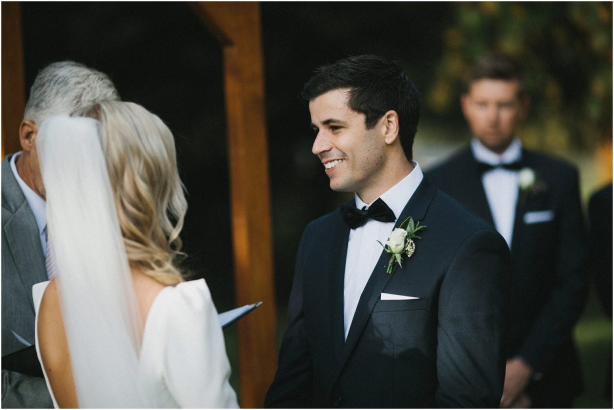 A groom during his wedding vows