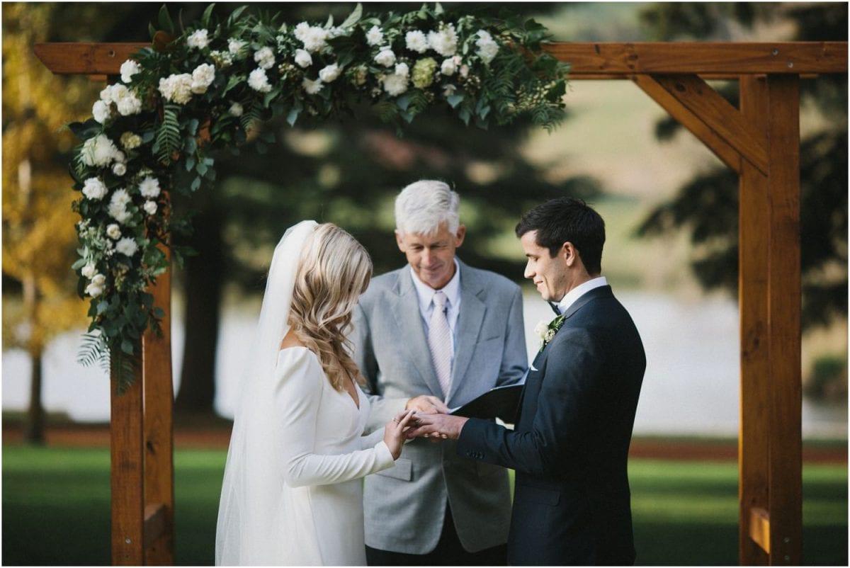 Bride and groom exchange rings during their Bendooley Estate wedding