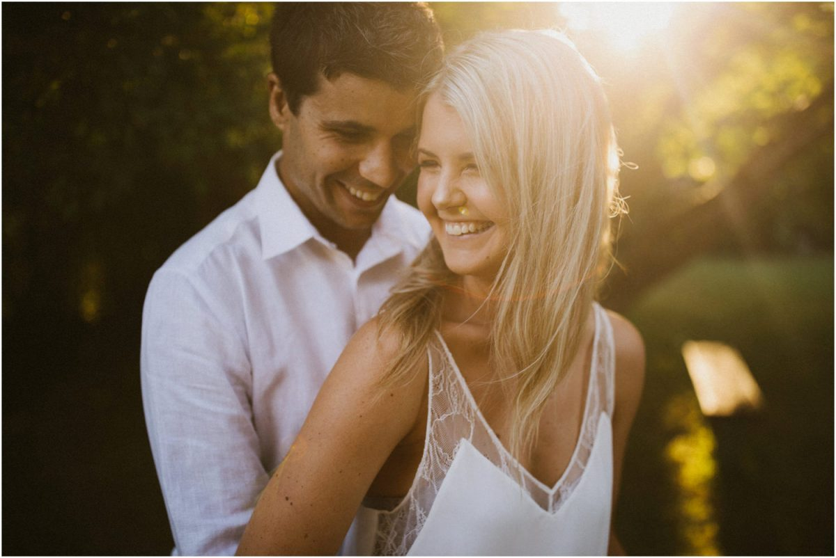 Couple smile in the sunlight before their wedding, taken my me, a Bowral photographer