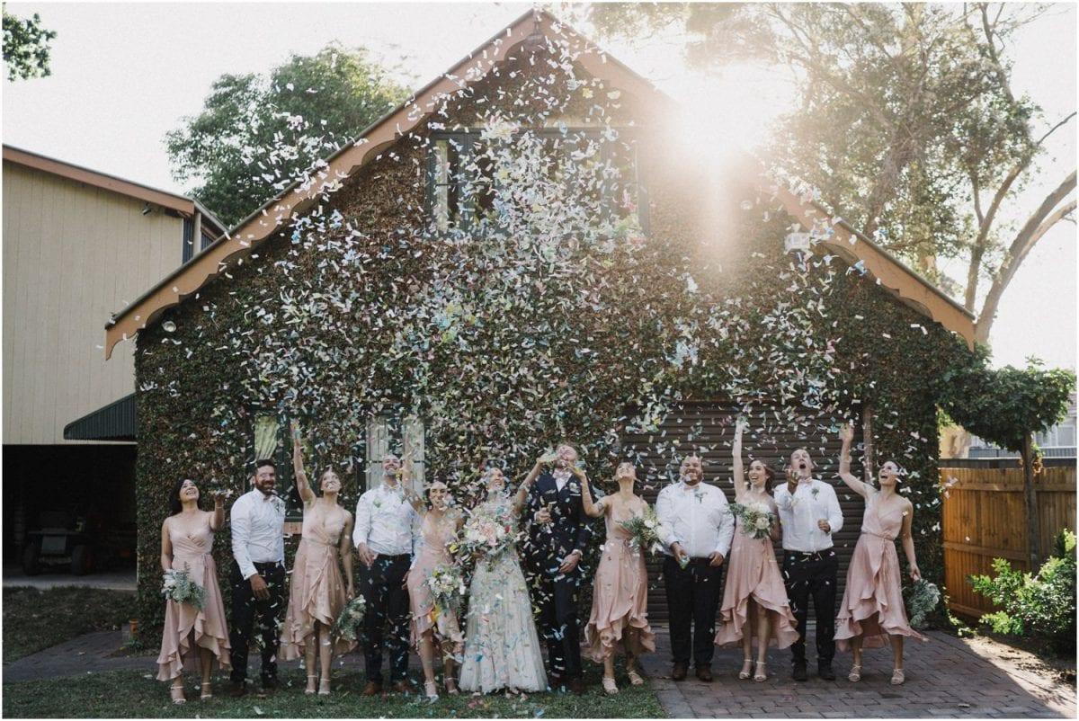 A bridal party throw a mountain of confetti all over themselves at an Italian Food Project wedding