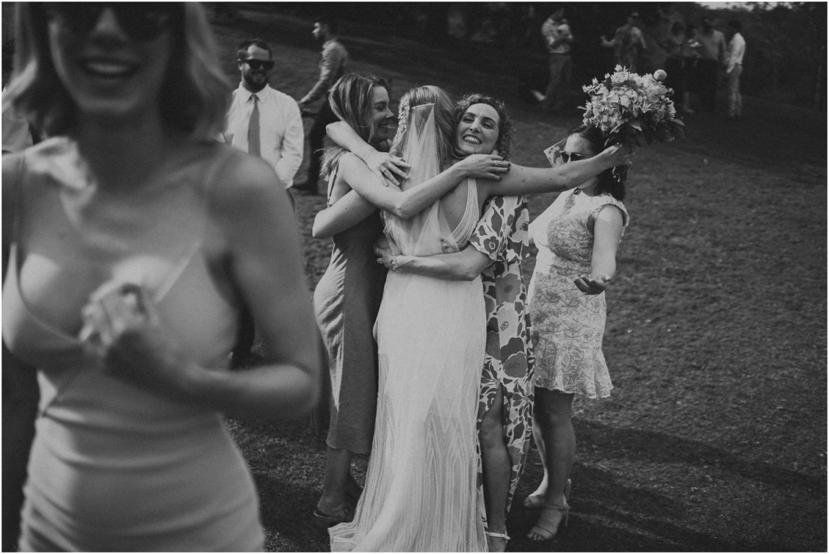 A bride's friends hug her after her Bundanon Trust Riversdale wedding