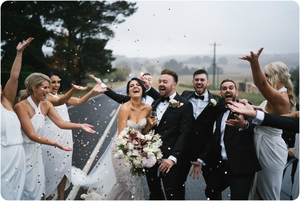 A bridal party throw confetti at a Bendooley Estate wedding shot by Southern Highlands wedding photographer Thomas Stewart