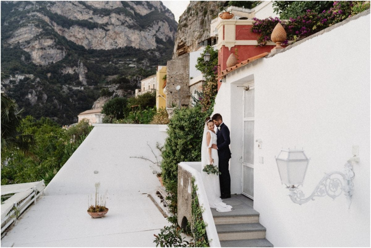 A bride and groom embrace at their Amalfi Coast wedding at Villa Oliviero in Positano