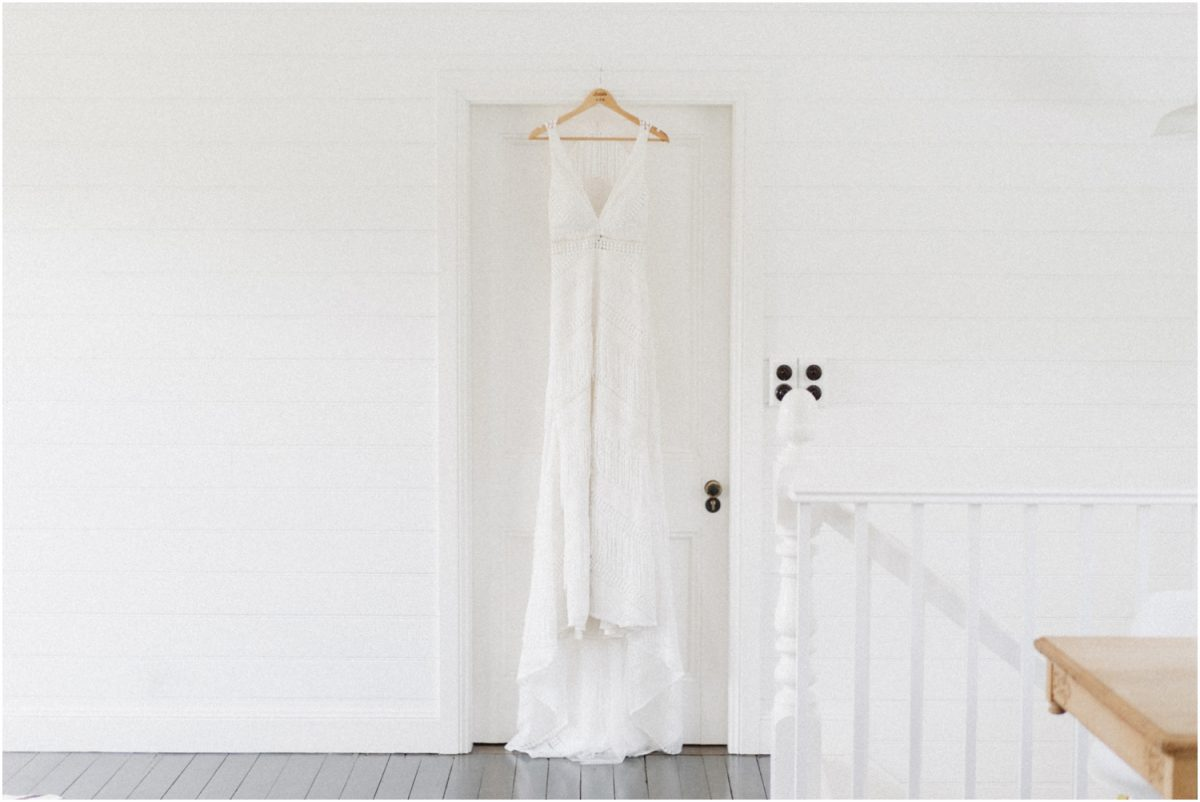 Wedding dress hanging in a doorway at The Rift Bowral in the Carriagehouse