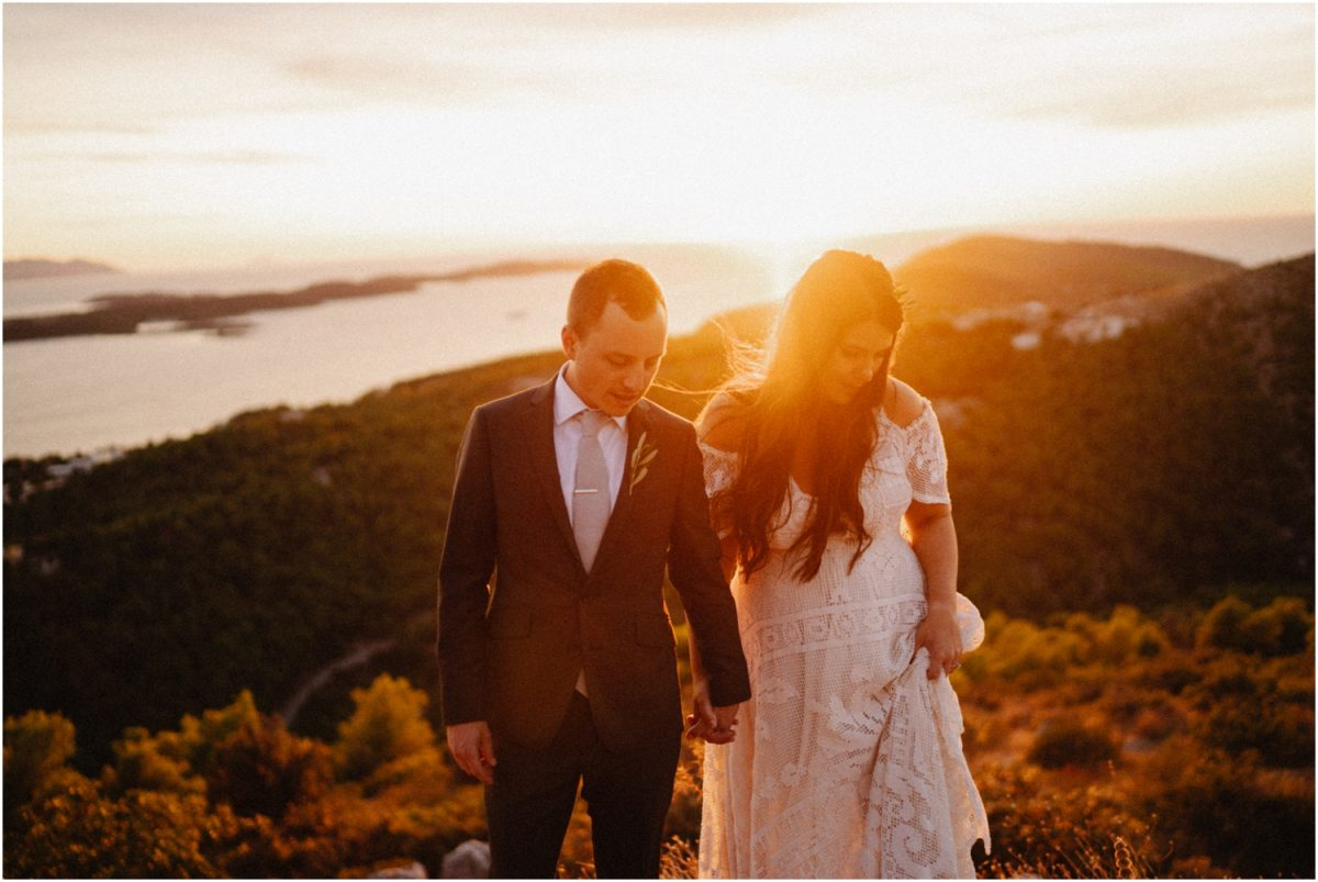 Calee and Cody stand on a mountain near the old town after their Hvar wedding