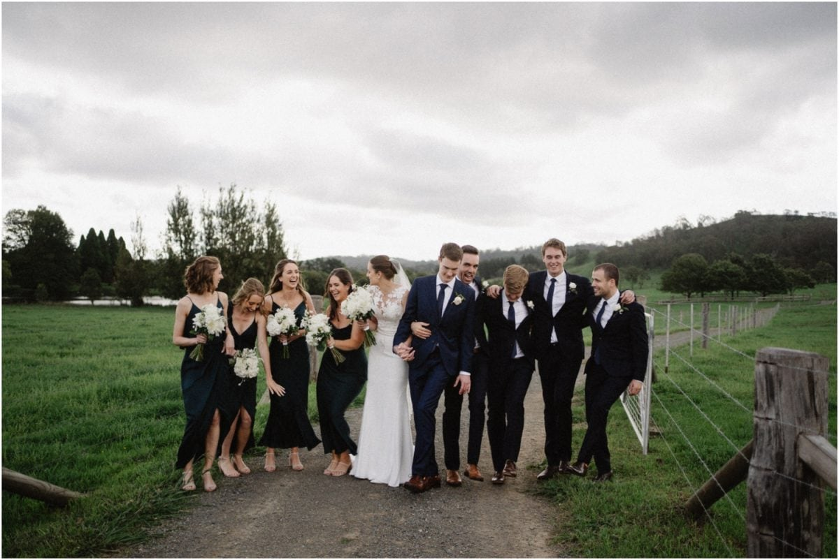 A bridal party laughs at a Stables Bendooley Estate wedding