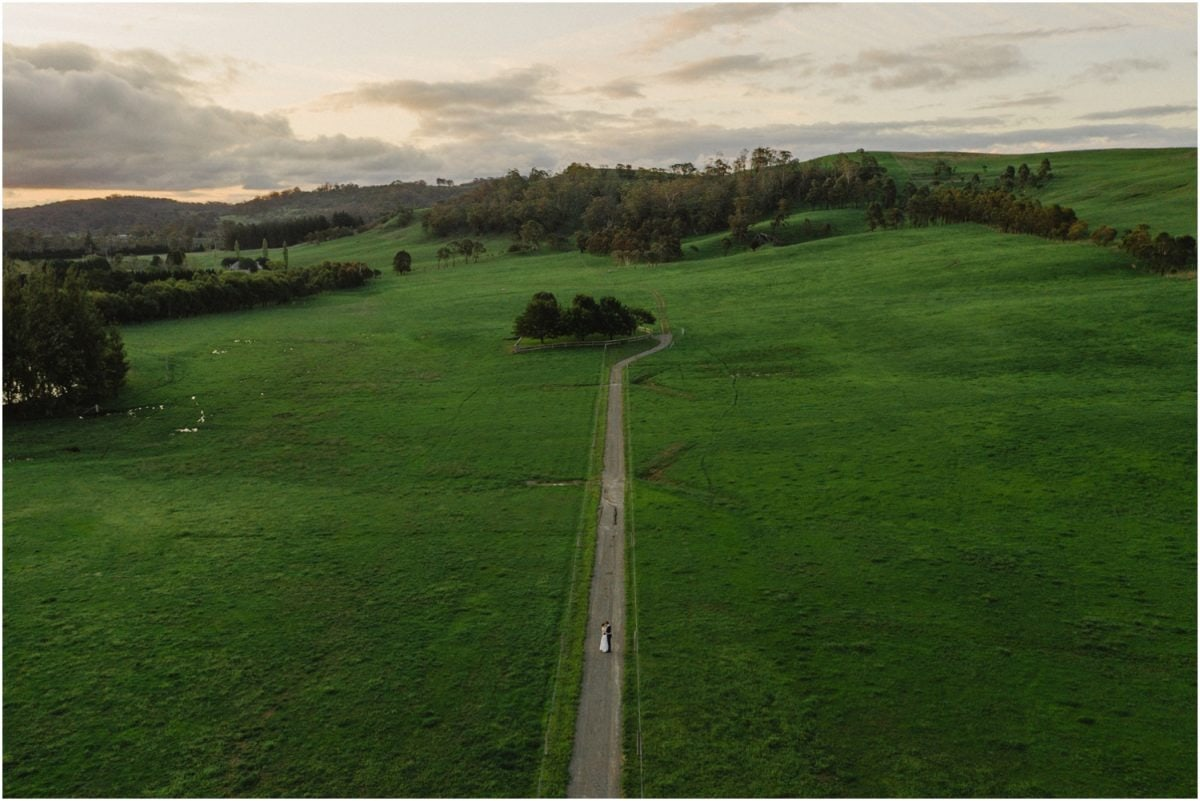 A drone shot of a newly married couple after their Stables Bendooley Estate wedding
