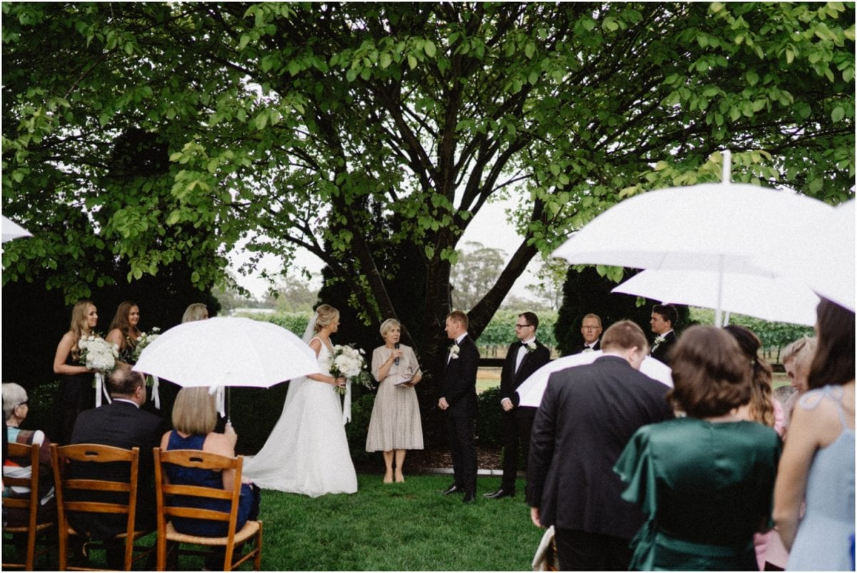 A beautiful and rainy Centennial Vineyards Restaurant Wedding ceremony in Bowral