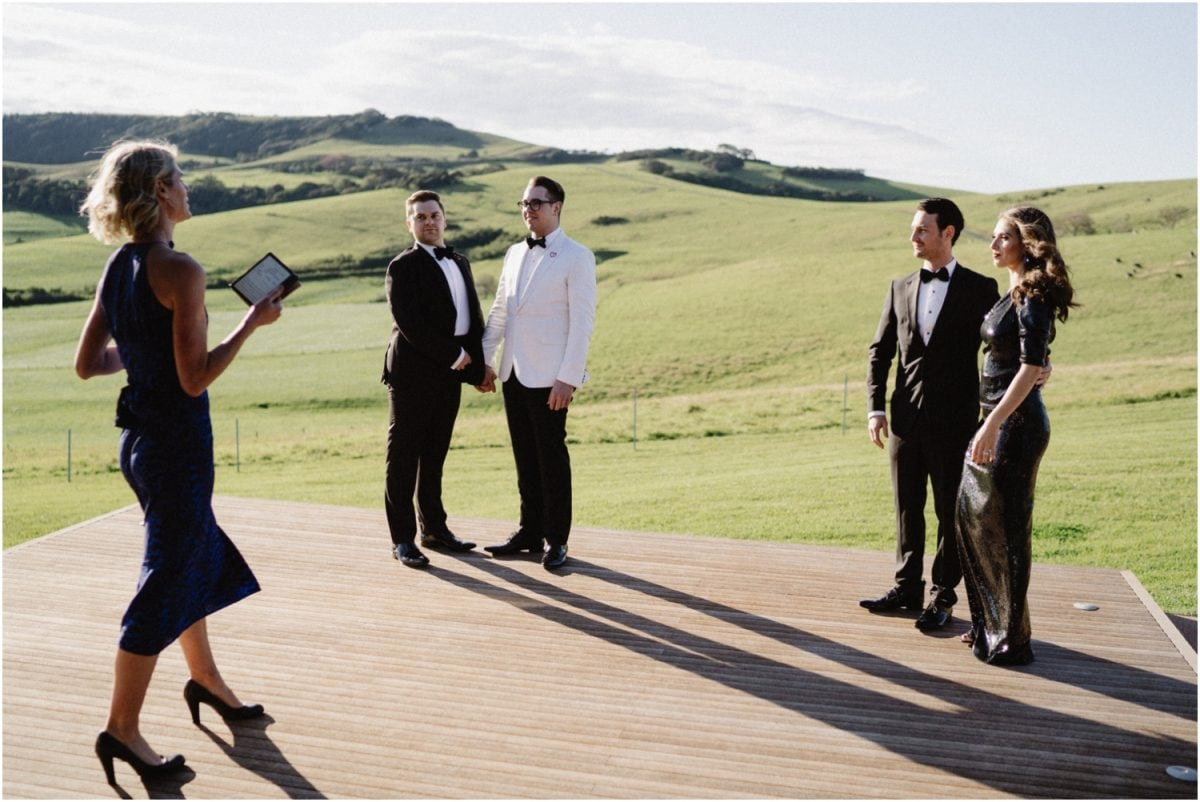 a beautiful dovecote gerringong wedding ceremony on an outside deck with rolling hills in the background