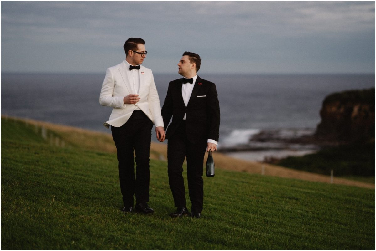 a newly married same sex couple walk in the hills after their dovecote gerringong wedding