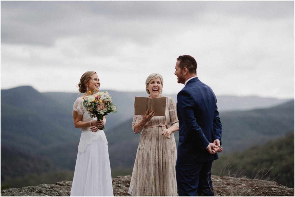 A couple read their vows to each other at their intimate Kangaroo Valley elopement